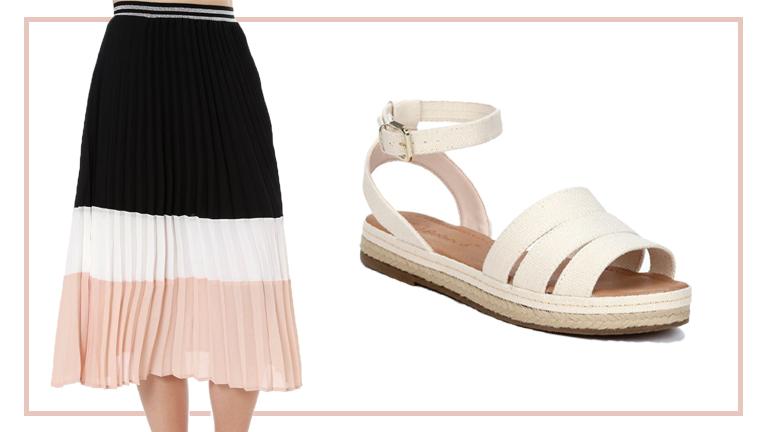 Na foto, temos uma modelo no detalhe usando saia plissada midi, nas cores rosa, nude e preto e, ao lado, uma rasteirinha bege com tiras