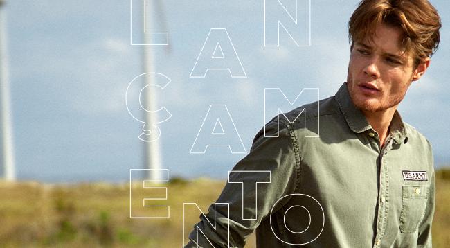 """Revista Pompéia: o post é uma foto, clicada em ambiente externo, com um modelo usando camisa em verde militar. Temos o lettering """"lançamento"""" no centro da imagem."""